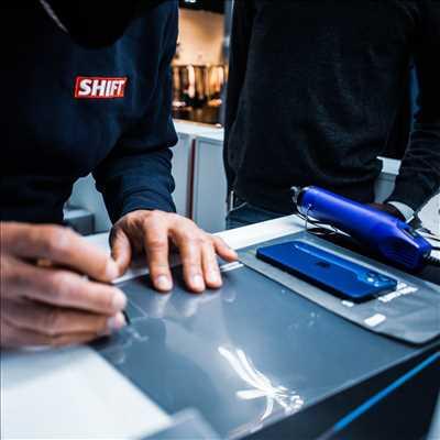 Photo de réparation de téléphone n°908 à Paris par SHIFT